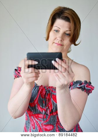 Adult Woman Looking At Mobile Phone