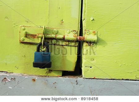Padlock On A Green Painted Door