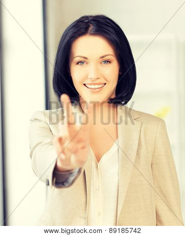 bright picture of young woman showing victory sign
