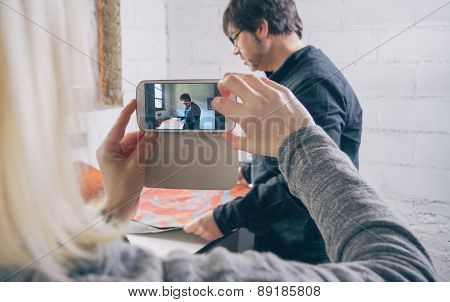 Woman hands taking photo to painter artist working