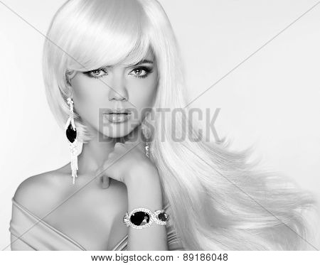 Beautiful Blond Woman Model With Long Wavy Hair. Luxury Jewelry. Glamour Concept. Studio Fashion Pho