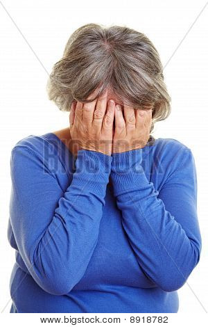 Crying Elderly Woman Covering Face