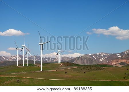 Wind Farm At Sun Spring Day