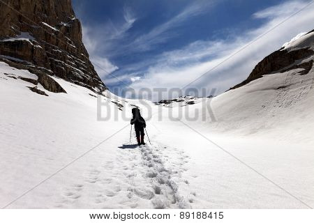 Silhouette Of Hiker On Snow Plateau