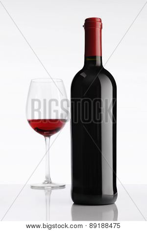Glass With Red Wine Bottle On White Background