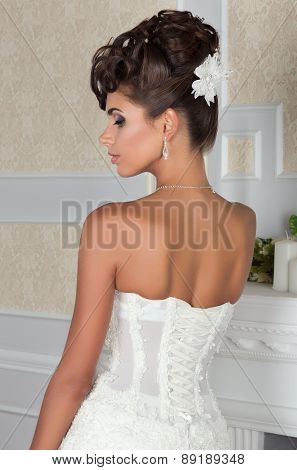 Young Beautiful Bride Standing Back To Camera