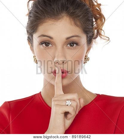 Portrait of attractive young women with finger on lips