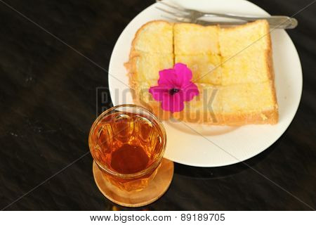 Bread, Butter, Topped  Milk With Tasty And Tea