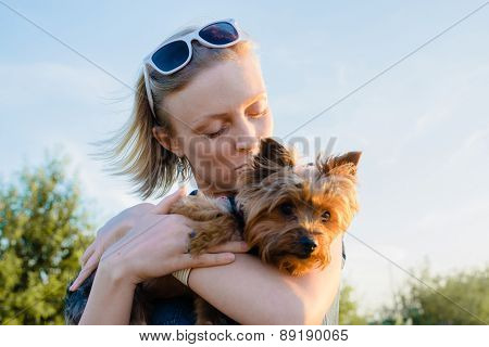 Beautiful Young Happy Woman With Blonde Hair Holding Small Dog
