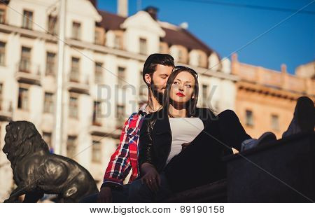 Happy Couple Sitting In The City