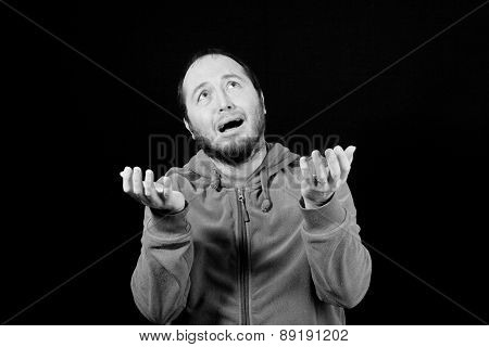 man praying holding hands open isolated on black background