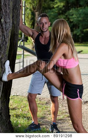 Stretching In A Park