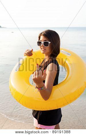 Girl Showing Rude Gesture On Beach On Tropic Island