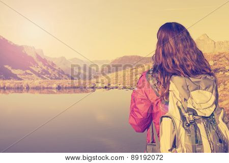 Hiking Woman Enjoying The Swiss Alps Landscape