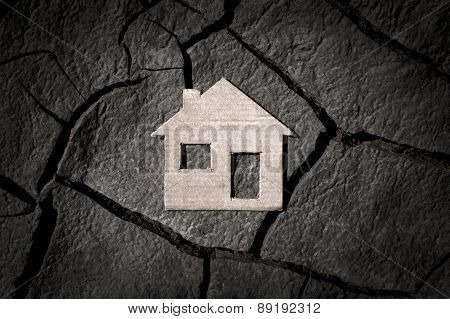 Paper House On Cracked Earth