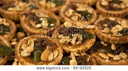 Almonds, Nuts And Raisin Tart