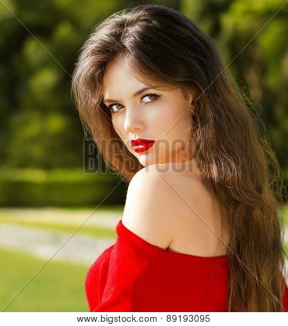 Outdoors Portrait Of Attractive Sensual Girl In Red With Long Hair. Romantic Model Posing In Green P