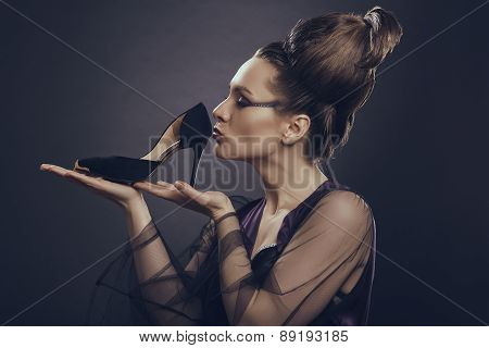 Woman Kissing High Heel Shoe