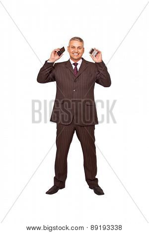 A brazilian business man busy on callings isolated on white background.