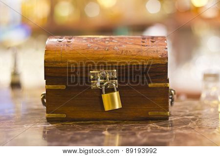 treasure box with lock used for tips waiter in restaurant