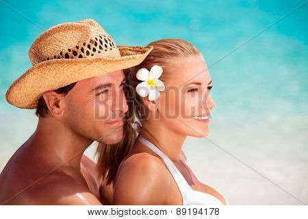Portrait of beautiful young couple on the beach, affectionate gentle family in romantic summer vacation, holidays and travel concept