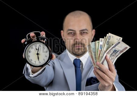 man holding money and alarm wearing a business suit, race against the clock, deadline
