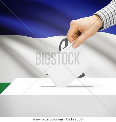 Voting Concept - Ballot Box With National Flag On Background - Lesotho