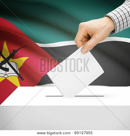 Voting Concept - Ballot Box With National Flag On Background - Mozambique
