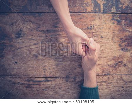 Man And Woman Engaged In Thumb War