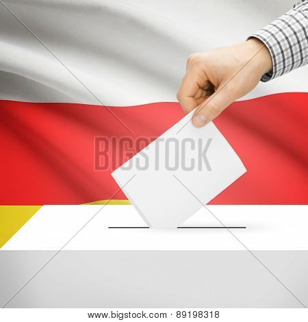 Voting Concept - Ballot Box With National Flag On Background - South Ossetia
