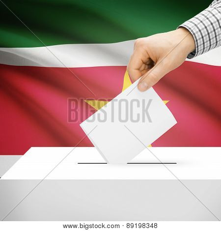 Voting Concept - Ballot Box With National Flag On Background - Suriname