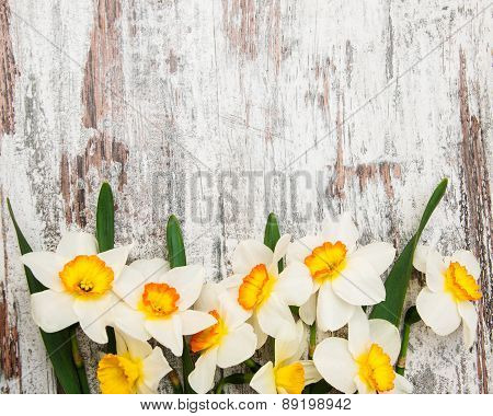 Daffodils On A Wooden Background