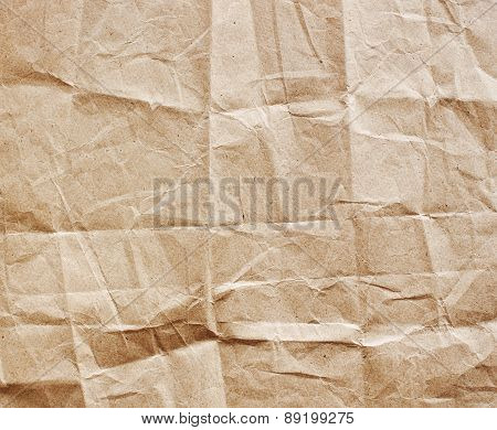 Old crumpled, recycled brown paper texture