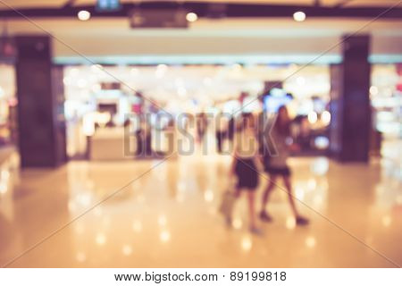 Blur Background Photograph Of Pretty Girl In The Department Store Building In Vintage Color