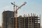 foto of construction crane  - Building construction site with cranes under clear sky - JPG
