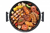 stock photo of marinade  - Assorted delicious grilled meat with vegetable over the coals on a barbecue - JPG