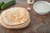 picture of pita  - a stack of flat pita breads on textured stone background - JPG