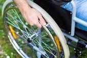 pic of wheelchair  - Paralyzed man using his wheelchair - JPG