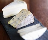 pic of serving tray  - assorted gourmet cheese on slate serving tray - JPG