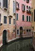 stock photo of planters  - Buildings with windows and planters in narrow canal in Venice - JPG