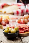 pic of charcuterie  - Charcuterie assortment and olives on wooden background - JPG