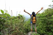foto of open arms  - cheering woman hiker open arms at mountain peak - JPG