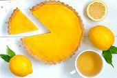foto of tarts  - Homemade fruit lemon tart pie with green tea on white rustick table background - JPG