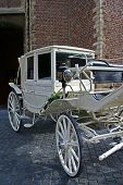 foto of cinderella coach  - wedding carriage with rose composition in front of church - JPG