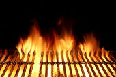 stock photo of flames  - Empty Flaming Charcoal Grill With Flames Of Fire On Black Background Closeup - JPG