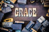 image of word charity  - The word GRACE written in rusted metal letters surrounded by vintage wooden and metal letterpress type - JPG