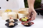 stock photo of chinese menu  - Chef presented Chinese Dim Sum  - JPG