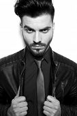 image of pull up  - Close up picture of a young handsome business man pulling his leather jacket - JPG