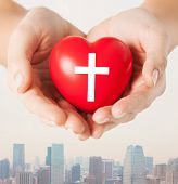 Постер, плакат: religion christianity and charity concept close up of female hands holding red heart with christi