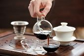 pic of brew  - China tea ceremony with puerh tea brewing in haiwan horizontal - JPG